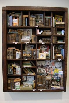 unique copy  these libraries in miniature, are produced using old drawers of typography Bodoni that served to contain the characters that would later compound the array of printing. After having restored the tray is passed to the realization of a specific theme of the project by entering into special almost all made ​​by hand. there are games like Monopoly, Chinese checkers, chess, ping pong, and playing cards, which I built.  There are about 110 books    size cm 22,5x30 corresponding to 1…