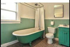 Green vintage bathroom. Claw foot tub.