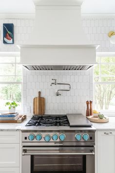 Farmhouse style kitchen renovation with upscale stove and hood vent