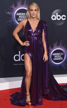 Carrie Underwood from American Music Awards Red Carpet Fashion Carrie Underwood from American Music Awards Red Carpet Fashion Carrie Underwood is wearing a purple sequin Stello gown.<br> In Stello by Stephanie Costello Carrie Underwood Legs, Carrie Underwood Pictures, Nick Cannon, Taylor Swift, Angela Simmons, Blue Ivy, Kendall Jenner Outfits, Purple Gowns, Purple Dress