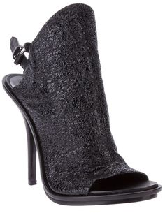 Black leather ankle boot from Balenciaga featuring a sling back ankle strap with silver-tone buckle, textured leather front, open toe and nigh stiletto heel.