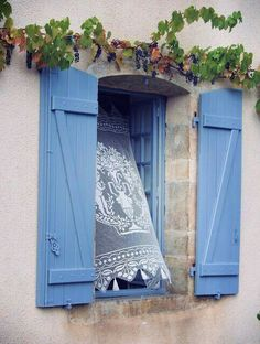 Don't know where it is, but I love this window and its bellowing lace curtain