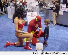 kid lost his dad in the crowd, and went to Flash and wonder woman