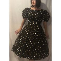 """Vintage 1950's Organza Polka Dot Full Party Dress So cute and fun! Great 60's party dress with Painted cream polka dots on black organza fabric. The dress also has reddish brown polka dots that I think are actually fading of some sort but create a really cool effect throughout. Metal zipper in back. Original Belt included. Square neckline, puffy sleeves, fully lined. I actually have two of these dresses. 36"""" chest, 27"""" waist, 39.5"""" length. From an estate in San Antonio, Texas Vintage Dresses"""