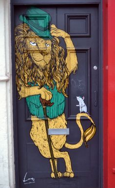 A lion and a mouse, and a very suave lion at that :) - Stokes Croft, Bristol (taken by me).