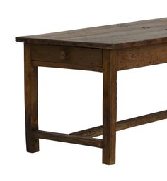 This is a fabulous 19th Century French pine and cherry wood table. The legs of the table are cherry wood while the rest of the table is constructed of pine. It has 3 drawers, one at each end and one in the the middle along one side.  This table has had considerable woodworm over the years – most of this evident on the underside and legs of the table, despite this the table is very solid with no wobbles.