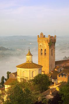 A misty dawn above the medieval town of San Miniato, Tuscany, Italy