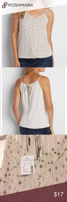Maurices Pleated Chiffon Tank Brand new with tags. Description: soft knit fabric back, pleated chiffon front is lined, patterned with subtle silvertone metallic shimmer, keyhole back with adjustable tie, elastic banded bottom hem Maurices Tops Tank Tops