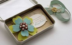 DIY felt hair accessories in a cutely packaged tin...but would be a great idea as a gift box for jewelry or other small trinkets
