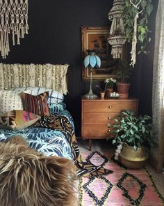 love the dark wall and the wrapped headboard. Maybe watch for a fancy full-sized throw blanket.I love the dark wall and the wrapped headboard. Maybe watch for a fancy full-sized throw blanket. Bohemian Interior Design, Bohemian Decor, Home Interior Design, Dark Bohemian, Modern Bohemian, Bohemian Style, Home Bedroom, Bedroom Decor, Modern Bedroom