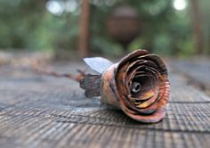 This listing is for a harvest copper rose that is a tight rose bud. The harvest copper color is created with process that creates a dark smokey copper with hints of red. Handmade in the USA. Each rose is hand cut, hand hammered with approximately 10,000 hammer strikes per a rose. Each petal of the roses are then hand formed to create the natural beauty of a rose. All our roses are created to have a realistic look similar in size to a real rose. Every rose is different as the handmade process…