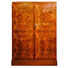 """1930 """"Compactom""""  Burr Walnut Wardrobe   From a unique collection of antique and modern commodes and chests of drawers at https://www.1stdibs.com/furniture/storage-case-pieces/commodes-chests-of-drawers/"""