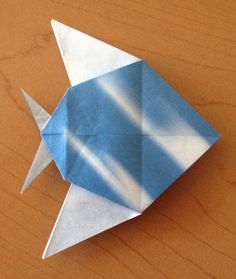 "The third model from the book ""ORIGAMI from Angelfish to Zen"" by Peter Engel. Its a Discus Fish.  Happy Folding!  Ed"