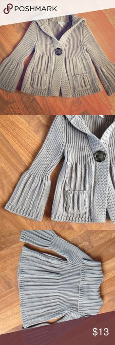 Girl's Sweater Girl's size M gray knit sweater. Button in front is decorative and is actually a large snap closure that's easy for small hands! Flared sleeves and sailor-style collar. 2 small pockets in the front. Great condition and from a smoke-free home. Shirts & Tops