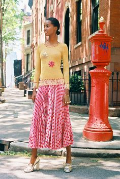 Leila Rahimi, 24, in her own tank, vintage turtleneck, Gucci plissé skirt, embossed belt with feline buckle and GG Marmont metallic pumps.