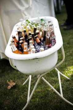 A vintage bathtub makes for a very interesting vessel for colorful bottled soda and beer.