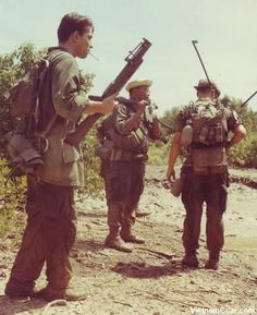 Members of the 1st Platoon, Co 'C', 4th Bn., 47th Inf., 9th Inf., Div., pause for a radio check during a patrol. The soldier in the foreground carries an M79 Grenade Launcher. Photo taken: October 1968