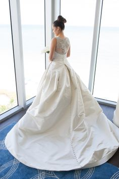 Love the back on this classically tailored Victor Harper Couture wedding dress