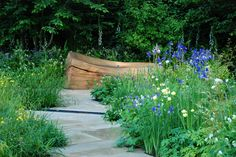 Bench in Homebase Garden RHS Chelsea 2014 - However large of small your garden is, introducing deliberate focal points will help to create a journey around your garden.