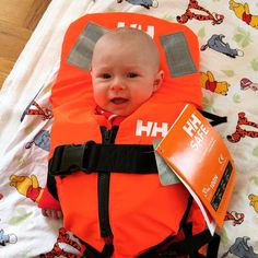 This Helly Hansen baby is ready for anything in an adorable orange life vest!  Photo from @ holger_puffa Instagram.