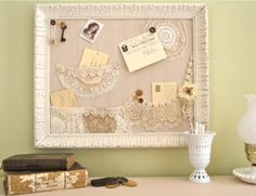 Make a Shabby Bulletin Board with Lace Pockets.  I could made this for hubby's fundraising dinner/silent auction.  It would go over very well.