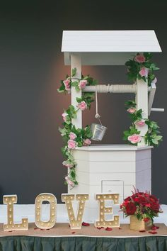 A wishing well to hold well wishes for your wedding? - Styled by Rosette Designs & Co.