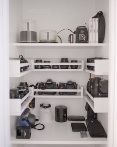 My husband built me a camera closet! We used the coat closet near our front door (which never really housed any coats...) and converted it into a storage closet for my gear. First he installed a fe...