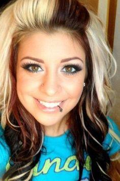 bleach blonde with dark brown in the bangs and dark brown or black underneath w/ blonde & red underneath too (: