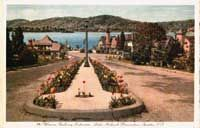 A vintage postcard pic of Winona Parkway leading into White Deer Plaza. Krogh's is to the left off the picture.