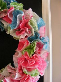 Cupcake Liner Wreath. How cute would this be for a themed birthday party?!