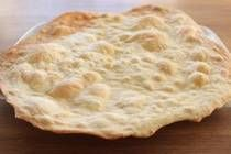 Lavash is thin and crispy flatbread - more like a cracker than bread. Making your own is easier than you might think and you can serve the homemade flatbread with a cheese plate or use it as a pizza crust.