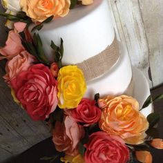 Crepe paper peonies on a rustic style cake