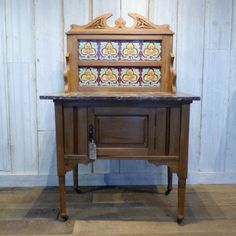 This pretty marble topped satinwood majolica-style tiled wash stand is practical and elegant. The top is removable for ease of transportation. There is a practical cupboard space below, and all legs are set on castors.  A petite & feminine addition to your bedroom or bathroom, it would look fabulous dressed with a wash jug & bowl or a collection of vintage perfume bottles.  #cheshire #reclamation #salvage #antiques #collectables #vintage #retro #home #furniture