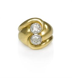 A Retro gold ring set with two old mine diamonds in a juxtaposed swirled design, in 18k and platinum. By Suzanne Belperron, France.