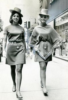Air hostesses on the streets of San Francisco, 1960s. The one on the left looks like Marianne from Gilligan's Island. The one on the right looks like Doris Day.