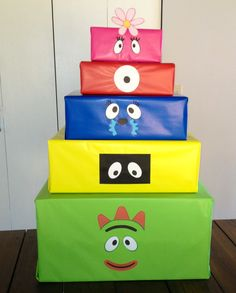Yo Gabba Gabba DIY present box. Just take old boxes, dollar store wrapping paper and print free printable iron on decals from nick jr.