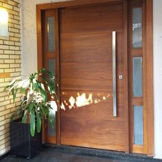 Simple modern main door with One Way looking glass on either side Modern Entrance Door, Main Entrance Door Design, Modern Exterior Doors, Modern Front Door, House Front Door, House Doors, Entrance Doors, Front Door Design Wood, Wooden Door Design