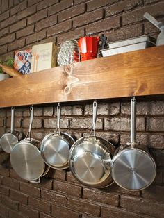 Free up kitchen cabinets and drawers by building your own wooden shelf for hanging pots and pans and storing a few of your favorite cook books.