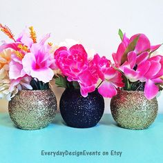 Set of 3 alternating glitter decorated Beautiful Round Glass Floral Vases, buffet candy bowls, or Candle Holders. The vases in this particular listing are decorated in glitter in the three designs you see in the main photo, and sealed to reduce glitter shedding. Many colors are available, Flowers & Candles are not included in listing. If you want all the vases done either fully coated, or in just one style shown above please add a note to your order or request a custom order.  The main ph...