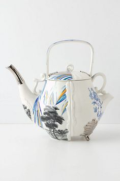 Double spouted teapot with two compartments for two different tea brews