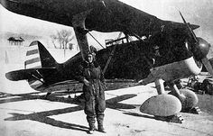 Chinese Air Force pilot Xu Huajiang with an I-15 fighter, date unknown