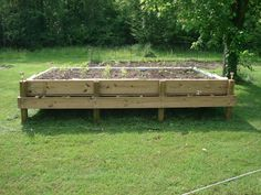DIY raised bed pallet garden. So doing this in my dirt back yard. It's easier than trying to grow grass!