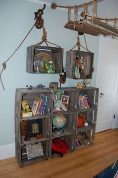 Great ideas and inexpensive for a pirate theme room! Swings bought from store to hang and crates from Walmart or Michael's. Get the rope wheel at hobby lobby. Pirate Room Decor, Pirate Nursery, Pirate Theme Rooms, Boys Pirate Bedroom, Deco Pirate, Pirate Kids, Pirate Baby, Deco Kids, Nautical Bedroom