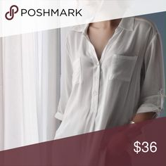 🆕Wainscott Blouse *Last 1! ◽️The Wainscott Blouse is chic and simple. Off white color with mother of pearl buttons, flattering airy fit. This is more of a delicate and is semi sheer, I am wearing a nude bra under - I would also love this with a black lace bra under for a sexy look.  100% rayon. New with tag.  ▫️Sizes available: L - last one! (S and M sold out) ▫️I am modeling size S ▫️Price is firm 📷 Photos are my own Tops Blouses