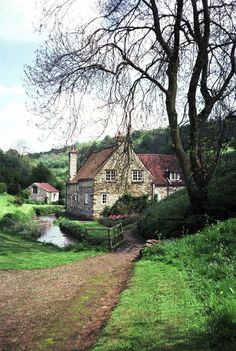 English stone house by river
