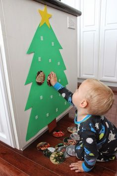 a Photo Christmas Tree for Babies & Toddlers Toddler Approved!: Build a Photo Christmas Tree for Babies & ToddlersToddler Approved!: Build a Photo Christmas Tree for Babies & Toddlers Photo Christmas Tree, Preschool Christmas, Noel Christmas, Christmas Crafts For Kids, Holiday Crafts, Outdoor Christmas, Christmas Birthday, Christmas Tree With Toddler, Christmas Ideas For Toddlers