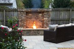 Not quite a fire pit or a fireplace. This Outdoor Dream features, what we like to call, a fire wall. For a clean, updated look, Blu 60 smooth pavers (from Techo-Bloc) were used on the patio.