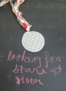 a cross stitch book mark charm and post about trying to get your writing/creative mojo back.