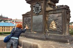 Rubbing the brass plaques on the Charles Bridge in Prague is said to bring luck or ensure a return to the city