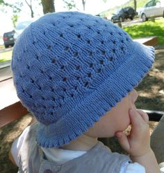 Free Knitting Pattern for Dear Liza Baby Sun Hat - This cute baby hat features a picot brim to keep the sun off baby's face and eyelets to keep head protected but cool. Designed by Annie Watts. Pictured project by nursenikkiknits
